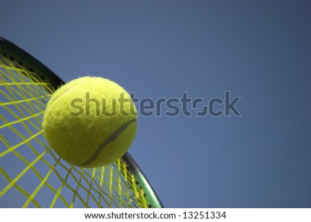 Tennis - Close up of a tennis ball and racket sky blue - stock photo