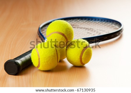 Tennis concept with balls and racket - stock photo