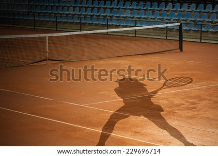 Tennis Court and player shadow - stock photo