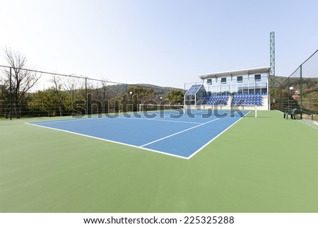 Tennis court in hotel sport center - stock photo