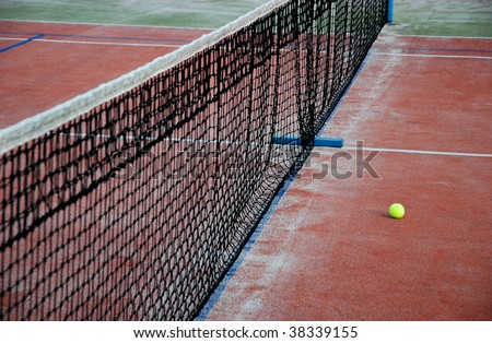 Tennis court, net and ball - stock photo