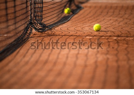 Tennis court with tennis balls and the net - stock photo