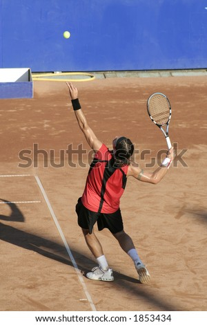 Tennis man in action serving the ball IV