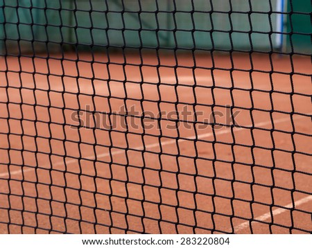 Tennis net details on the clay tennis court - stock photo