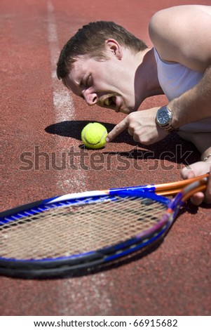 Tennis Player Challenges A Referees Judgment While Pointing To The Spot Where He Alleges The Ball Landed In A Line Ball Dispute - stock photo