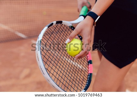 Tennis player. Close-up view of women's hand preparing to hit a ball, playing tennis on the court.