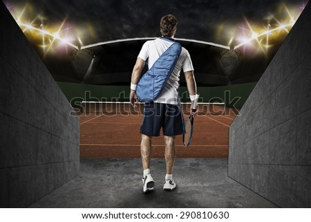 Tennis player, entering a clay tennis court. - stock photo