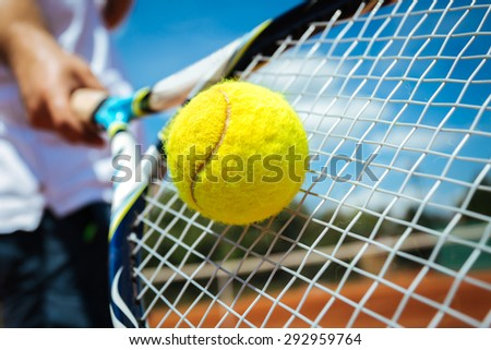 Tennis player playing a match - stock photo