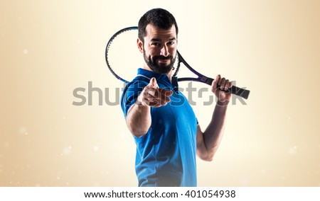 Tennis player pointing to the front