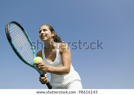 Tennis Player Preparing to Serve