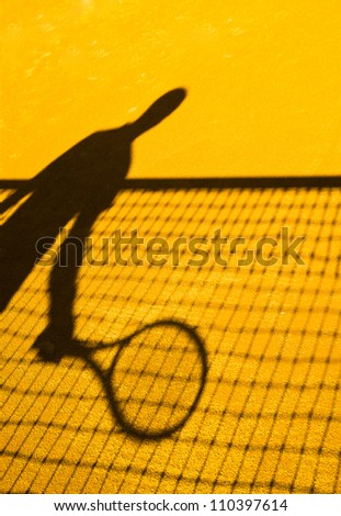 tennis player shadow - stock photo