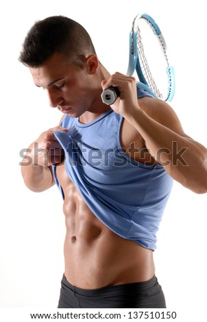 Tennis player watching his abdominal muscles. - stock photo