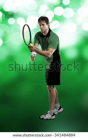 Tennis player with a green shirt, playing on green light background.