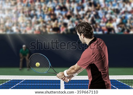 Tennis player with a pink shirt, returning a ball on a fast tennis court. - stock photo