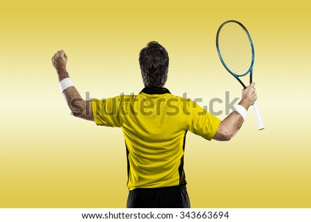 Tennis player with a yellow shirt, celebrating on a yellow background.