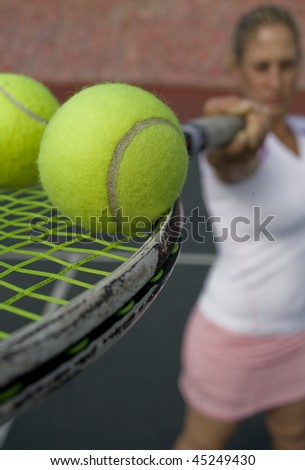 tennis player with balls - stock photo