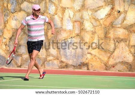 tennis player with racket on the court - stock photo