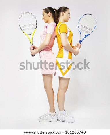 Tennis players women with rackets - stock photo