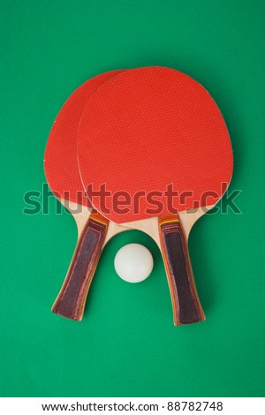 tennis racket and a ball on a green background - stock photo