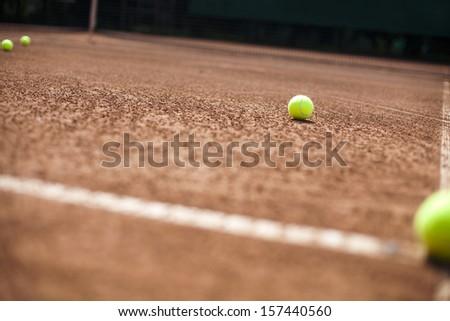 Tennis racket and balls, court - stock photo