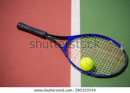 tennis racket and balls on the tennis court - stock photo