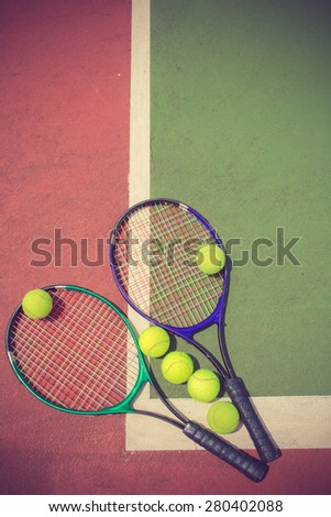 tennis racket and balls on the tennis court vintage color - stock photo