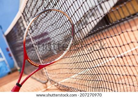 tennis racket and net - stock photo