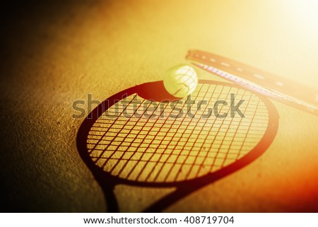 tennis racket and tennis ball on the court - stock photo