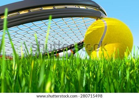 Tennis Racket Grass Front - stock photo