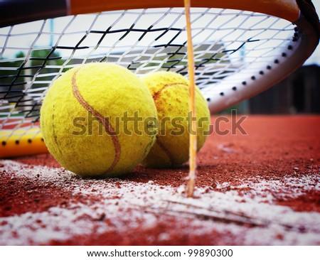 Tennis rackets and tennis balls - stock photo