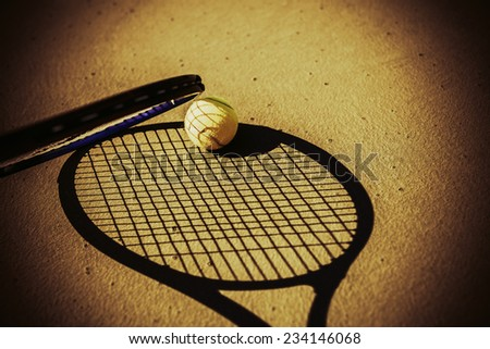 tennis rocket next to tennis ball on hard court - stock photo