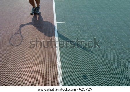 Tennis serve silhouette - stock photo