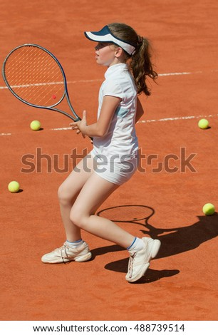 Tennis talent during the training on the clay court
