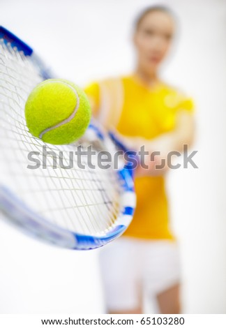 Tennis tournament - player woman with tennis racket and ball  Low-focus shot with focus on tennis ball - stock photo
