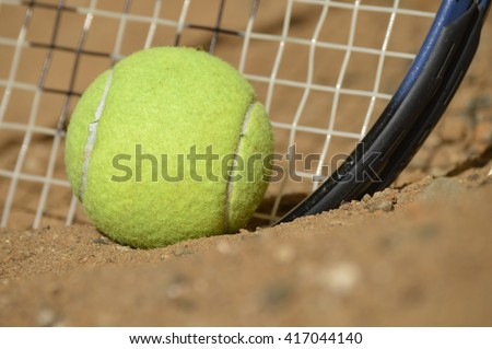 Tennis training in wilderness.In sport success or failure depends on many factors. These factors could be the weather, the referee or umpire, the skill of our opponent, or our own temperament. - stock photo