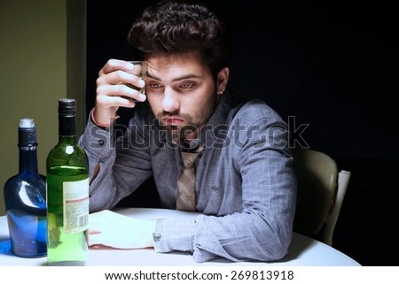 Tensed man in problem sitting in a bar. - stock photo