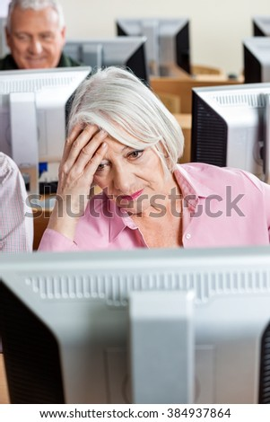 Tensed Senior Student Looking At Computer - stock photo