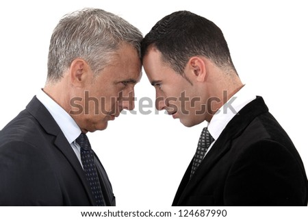Tension between two businessmen - stock photo