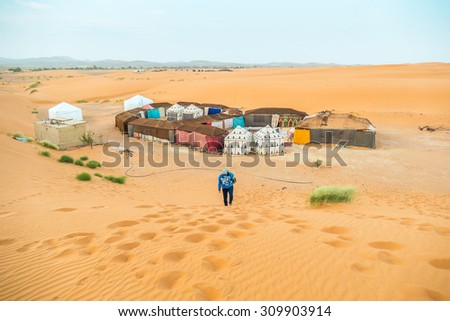 Tent camp for tourists in sand dunes of Erg Chebbi, Morocco - stock photo