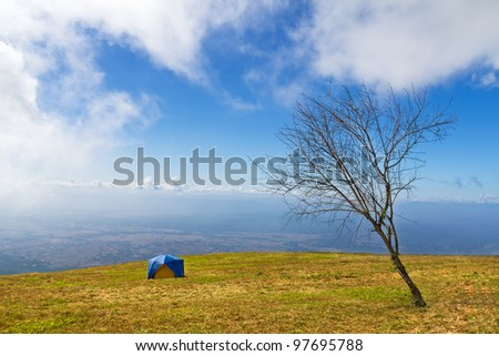 Tent camping in a campground  on mountain - stock photo