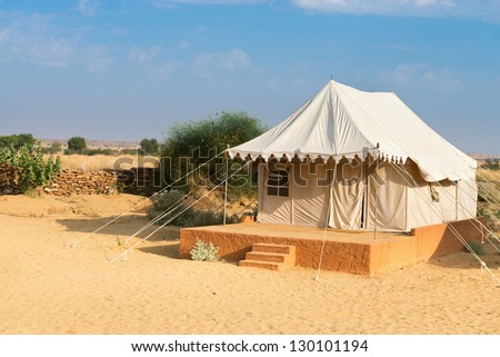 Tent in camping site hotel for tourist  in the thar desert under blue sky