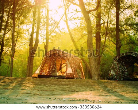 tent in forest trekking camp, for relaxation in natural outdoor - stock photo