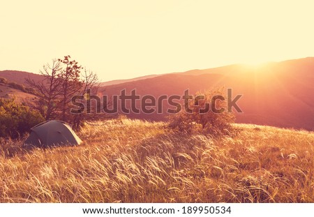 tent in grassland - stock photo