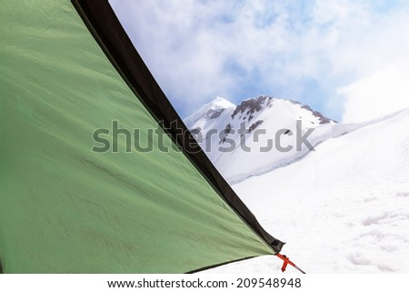 tent in high mountains - stock photo