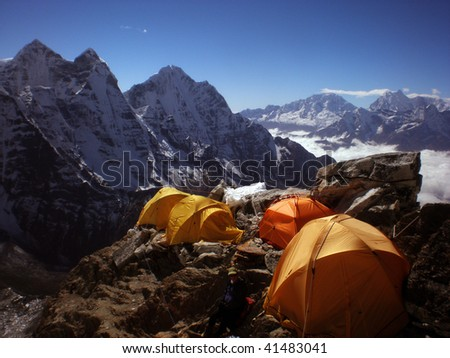 tent in sunny mountains - stock photo