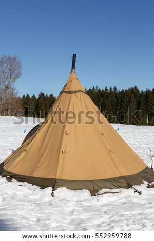 tent in the shape of a yurt winter on a background of snow in the afternoon & Traditional Sami Reindeerskin Tents Lappish Yurts Stock Photo ...