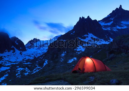 Tent in the Swiss mountains during an beautiful evening. - stock photo
