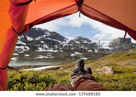 Tent Lookout with Hikers legs - stock photo