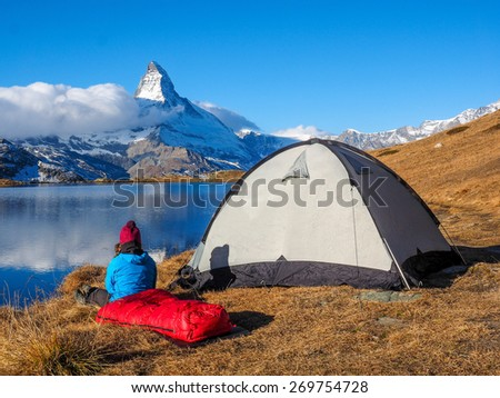 Tent near Matterhorn during early morning with relfection in StelliSee, Zermatt, Switzerland - stock photo