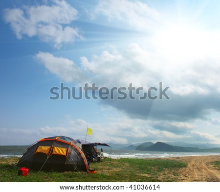 Tent on seaside under sunlight - stock photo